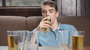 man-drinking-beers