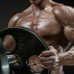 bodybuilder-stacking-plates-barbell-promo